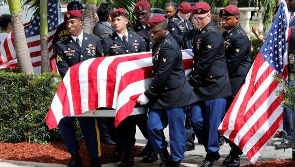 An honor guard carries the coffin of US Army Sergeant La David Johnson, who was among four special forces soldiers killed in Niger, at a graveside service in Hollywood, Florida, October 21, 2017. - Sputnik International