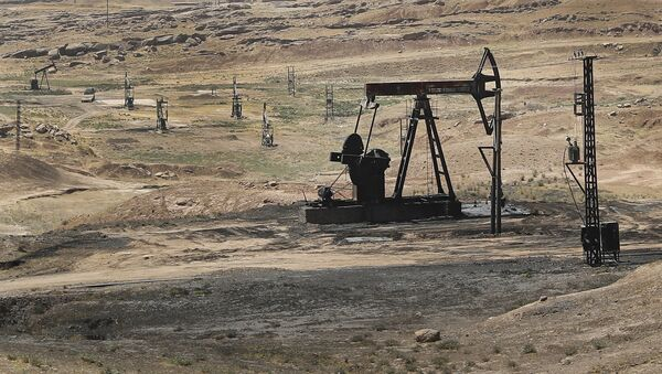 This July 30, 2017 photo, shows an oil field controlled by the Kurdish-led Syrian Democratic Forces (SDF), in Rmeilan, Hassakeh province, northeast Syria. - Sputnik International