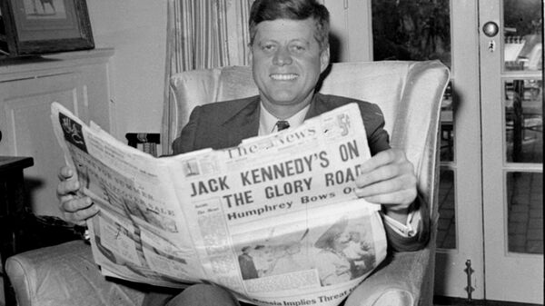 Sen. John F. Kennedy (D-MA) reads the daily newspaper accounts of his West Virginia election victory as he relaxes, May 11, 1960, in his Washington home. Kennedy defeated Sen. Hubert Humphrey (D-MN) in yesterday's presidential primary.  - Sputnik International