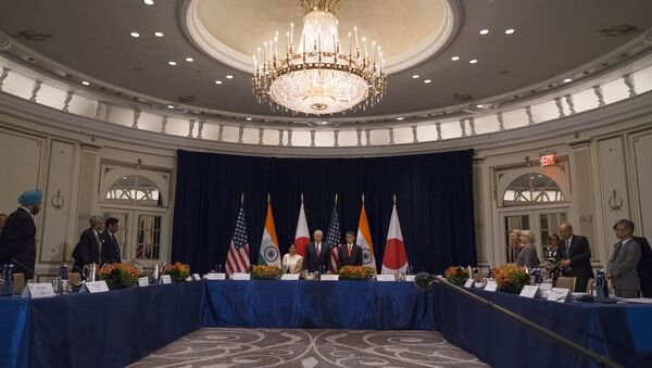 U.S. Secretary of State Rex Tillerson, center at center table, stands with Indian External Affairs Minister Sushma Swaraj, left, and Japanese Foreign Minister Taro Kono, at the Palace Hotel during a meeting in New York, Monday, Sept. 18, 2017 - Sputnik International
