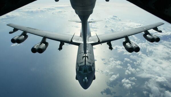 A US Air Force B-52 bomber returning from a mission over Iraq is refueling from a KC-10 plane over the Black Sea, in this Friday, March 28, 2003 photo - Sputnik International