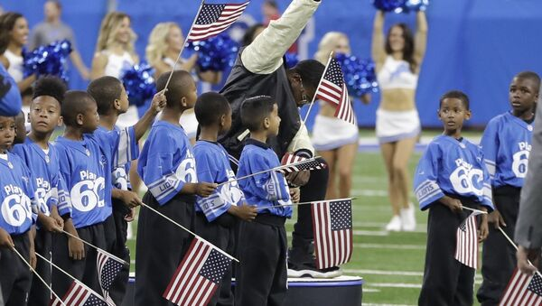 In a file photo from Sept. 24, 2017, National anthem singer Rico Lavelle bends to his knee, bows his head and raises his fist after singing the anthem before the first half of an NFL football game between the Detroit Lions and the Atlanta Falcons in Detroit. The sight of football players kneeling during the national anthem is the continuation of a tradition nearly as old the song itself. University of Michigan musicology professor Mark Clague says The Star-Spangled Banner has been a channel for protest since at least the 1840s. The lyrics were recast as an anti-slavery song and it's been used or reworked to push for racial equality, women's suffrage, prohibition and labor rights. - Sputnik International