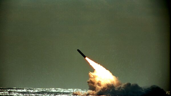 Dec. 4, 1989 file photo shows the launch of a Trident II, D-5 missile from the submerged USS Tennessee submarine in the Atlantic Ocean off the coast of Florida. As of mid-2010, 12 operational U.S. nuclear-missile submarines carry a total of 288 Trident missiles. A movement is growing worldwide to abolish nuclear weapons, encouraged by President Barack Obama's endorsement of that goal. But realists argue that more stability and peace must first be achieved in the world. - Sputnik International
