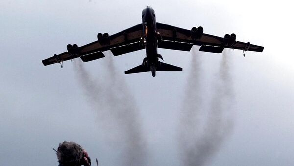 March 3, 2002 file photo shows a member of the public watching a US Air Force B 52 bomber arriving at RAF Fairford in western England. Pushing his vision of a nuclear weapons-free world, President Barack Obama returned to Prague on Thursday, April 8, 2010 to sign a pivotal treaty aimed at sharply paring U.S. and Russian arsenals — and repairing soured relations between the nations. With that, they will commit their nations to slash the number of strategic nuclear warheads by one-third and more than halve the number of missiles, submarines and bombers carrying them, pending ratification by their legislatures. The new treaty will shrink those warheads to 1,550 over seven years. That still allows for mutual destruction several times over. But it will send a strong signal that Russia and the U.S., which between them own more than 90 percent of the world's nuclear weapons, are serious about disarmament. - Sputnik International