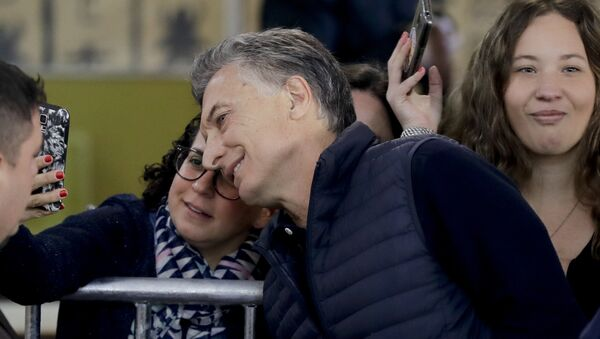 Argentina's President Mauricio Macri takes a selfie with supporters after casting his vote during midterm legislative elections in Buenos Aires, Argentina, Sunday, Oct. 22, 2017. - Sputnik International