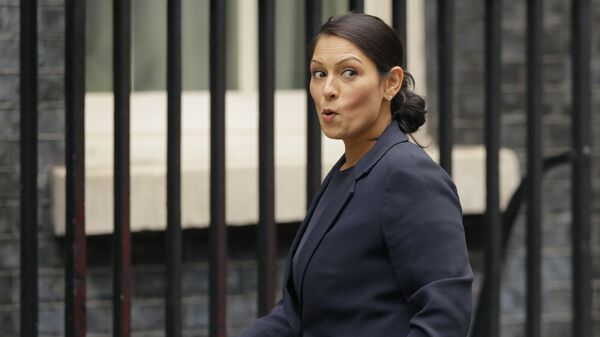 Britain's Secretary of State for International Development Priti Patel reacts to a question from the media as she arrives for a cabinet meeting at 10 Downing Street in London, Tuesday, Oct. 10, 2017.  - Sputnik International