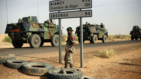 This Feb. 6, 2013, file photo shows French armoured vehicles heading towards the Niger border before making a left turn north in Gao, northern Mali. - Sputnik International