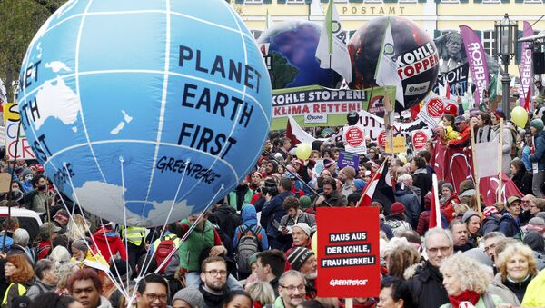 Protestors demand the implementation of the climate change convention in Bonn, Germany, Saturday, Nov. 4, 2017. The Climate summit starts Monday Nov. 6, in Bonn. - Sputnik International