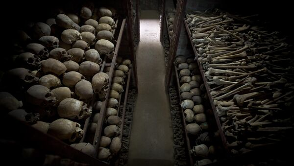 The skulls and bones of some of those who were slaughtered as they sought refuge inside the church, are laid out on shelves in an underground vault as a memorial to the thousands who were killed in and around the Catholic church during the 1994 genocide in Nyamata, Rwanda, Friday, April 4, 2014 - Sputnik International