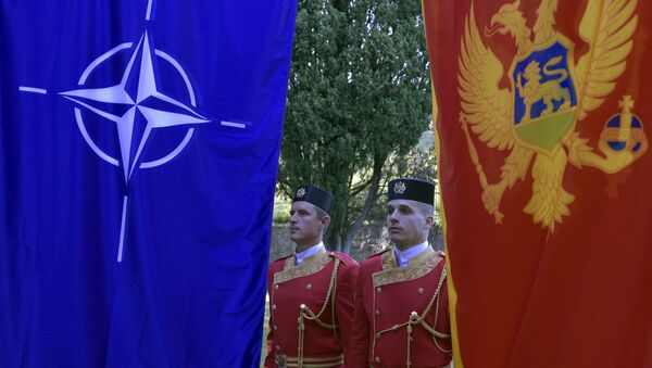Montenegrin guards of honor stand between NATO, left, and Montenegro flags during ceremony to mark Montenegro's accession to NATO, in Podgorica, Montenegro, Wednesday, June 7, 2017 - Sputnik International