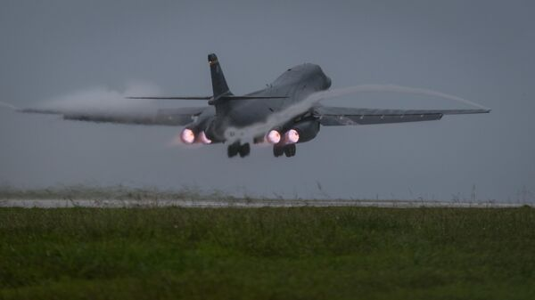 U.S. Air Force B-1B Lancer bomber assigned to 37th Expeditionary Bomb Squadron, deployed from Ellsworth Air Force Base, South Dakota, takes off from Andersen Air Force Base, Guam, to fly a mission with two Koku Jieitai (Japan Air Self-Defense Force) F-15s, Sept. 9, 2017 - Sputnik International