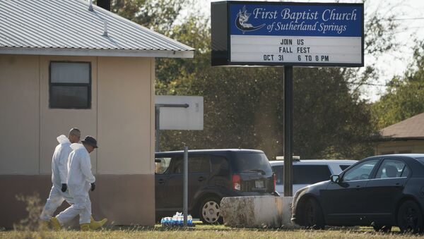 Members of the FBI walk next to the First Baptist Church of Sutherland Springs after a fatal shooting, Sunday, Nov. 5, 2017, in Sutherland Springs, Texas. - Sputnik International