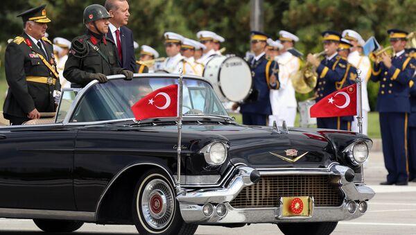 Turkish President Recep Tayyip Erdogan, right, and Chief of Staff Gen. Necdet Ozel, left, inspect the military on Victory Day in Ankara, Turkey, Saturday, Aug. 30, 2014. - Sputnik International