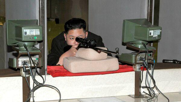 North Korean leader Kim Jong-Un aims a rifle at the Sporting Bullet Factory (File) - Sputnik International