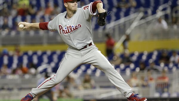 Philadelphia Phillies' Roy Halladay pitches against the Miami Marlins in the first inning of a baseball game, Monday, Sept. 23, 2013, in Miami. - Sputnik International