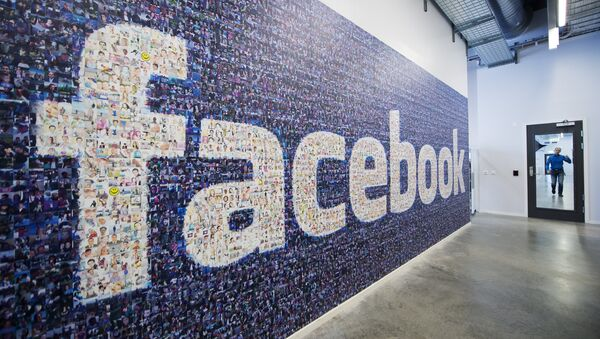 A big logo created from pictures of Facebook users worldwide is pictured in the company's Data Center, its first outside the US on November 7, 2013 in Lulea, in Swedish Lapland - Sputnik International