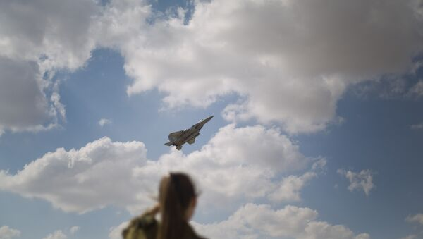 In this Wednesday, Nov. 8, 2017 photo, An Israeli soldier looks at an F-15s of the Knights of the twin tail 133 squadron takes off from Ovda airbase near Eilat, southern Israel,during the 2017 Blue Flag exercise. Israel's military is holding the largest ever air drill of its kind with pilots from eight countries simulating combat scenarios. It said Thursday that Germany, India and France are taking part for the first time in the two week drill codenamed blue flag, held every two years. - Sputnik International