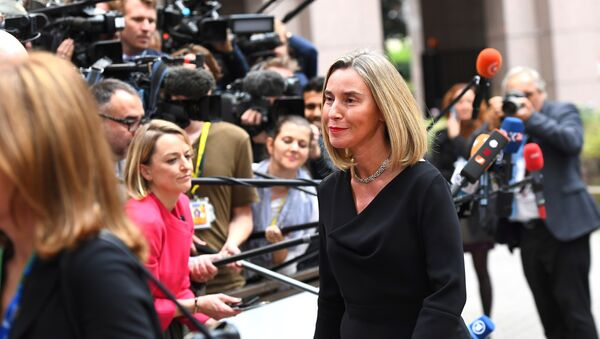 EU's High representative for foreign affairs and security policy Federica Mogherini (R) waves as she arrives in Brussels, on October 19, 2017 - Sputnik International