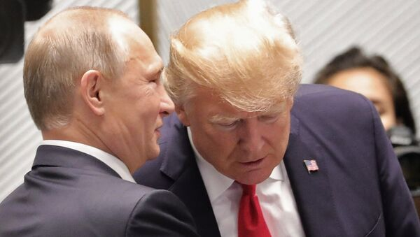 Russian President Vladimir Putin and US President Donald Trump, right, are seen here ahead of the first working meeting of the Asia-Pacific Economic Cooperation leaders - Sputnik International