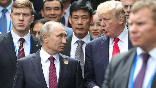 Russian President Vladimir Putin and US President Donald Trump are seen here ahead of the first working meeting of the Asia-Pacific Economic Cooperation leaders - Sputnik International