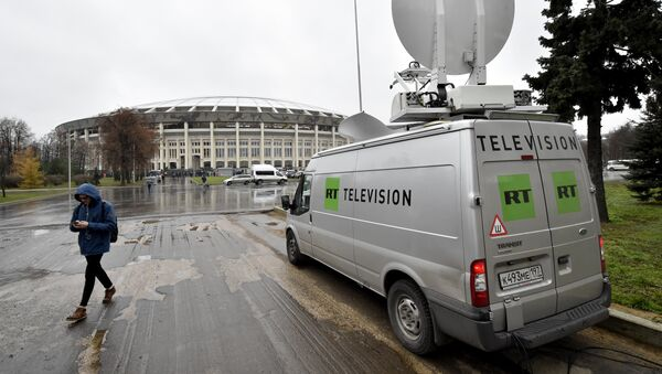A Russia's Russia Today (RT) television broadcast van is seen parked outside the Luzhniki stadium ahead of an international friendly football match between Russia and Argentina in Moscow on November 11, 2017 - Sputnik International