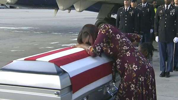 Myeshia Johnson cries over the casket of her husband, Sgt. La David Johnson, who was killed in an ambush in Niger, upon his body's arrival in Miami - Sputnik International