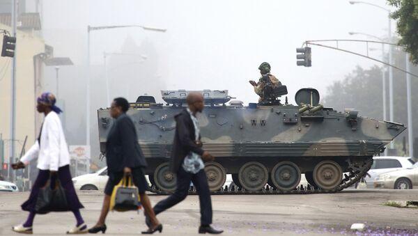An armed soldier patrols a street in Harare, Zimbabwe, Wednesday, Nov. 15, 2017 - Sputnik International