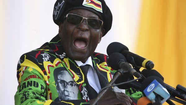 This file photo taken on November 04, 2017 shows Zimbabwe's President Robert Mugabe delivering a speech during the Zimbabwe ruling party Zimbabwe African National Union- Patriotic Front (Zanu PF) youth interface Rally in Bulawayo - Sputnik International