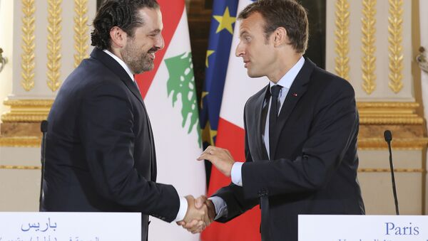 In this Sept. 1 2017 file photo, French President Emmanuel Macron, right, shakes hands with Lebanese Prime Minister Saad Hariri during a joint press conference at the Elysee Palace in Paris. - Sputnik International