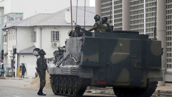 A military vehicle is seen on a street in Harare, Zimbabwe, Thursday, Nov. 16, 2017 - Sputnik International