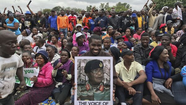 People gather to demonstrate for the ouster of 93-year-old President Robert Mugabe who is virtually powerless and deserted by most of his allies, in Harare, Zimbabwe, Saturday, Nov. 18, 2017 - Sputnik International