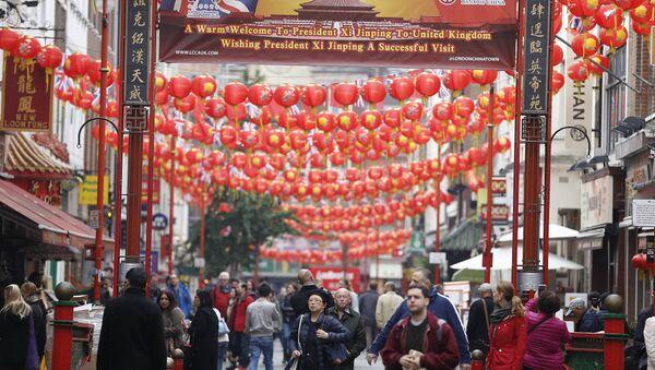 People walk through a decorated street in Chinatown, London, Friday, Oct. 16, 2015 - Sputnik International