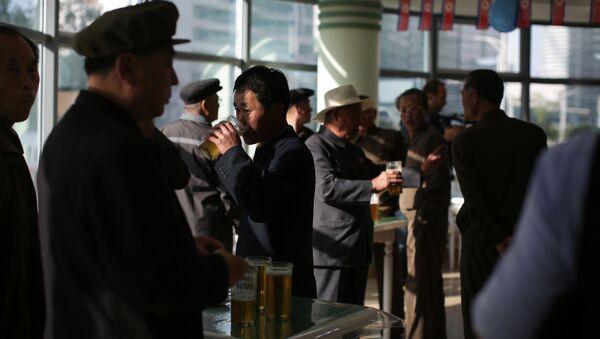 In this Saturday, May 7, 2016, photo, North Korean men drink beer at the Taedonggang Beer shop in Pyongyang, North Korea - Sputnik International