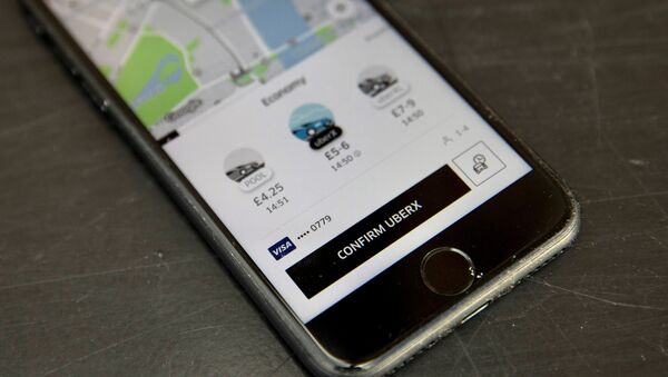 A photo illustration shows the Uber app on a mobile telephone, as it is held up for a posed photograph, in London, Britain November 10, 2017. - Sputnik International