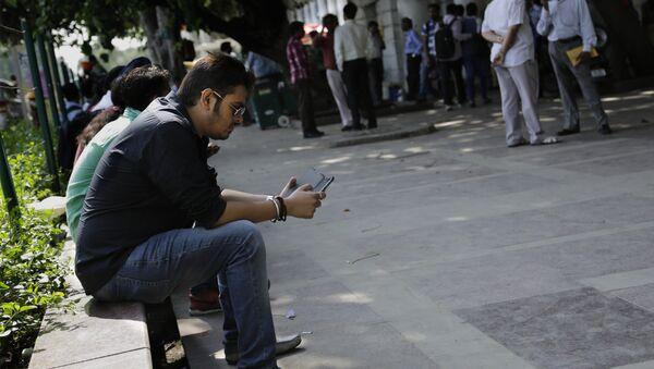 An Indian man uses his mobile phone in New Delhi, India. (File) - Sputnik International