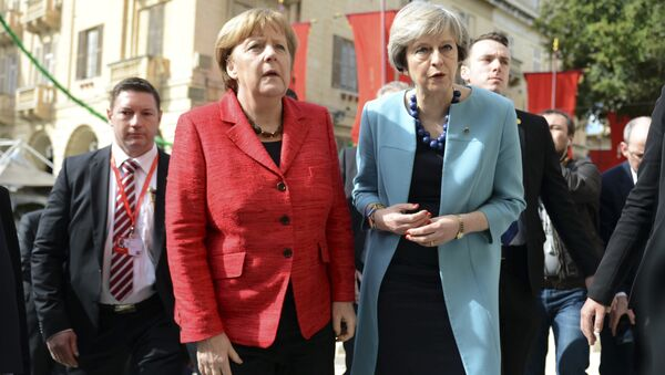 German Chancellor Angela Merkel, left, speaks with British Prime Minister Theresa May, right, as they walk with other EU leaders during an event at an EU summit in Valletta, Malta, on Friday, Feb. 3, 2017. - Sputnik International