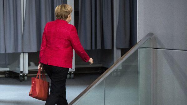 German Chancellor Angela Merkel leaves a plenary session of German parliament Bundestag in Berlin, Tuesday, Nov. 21, 2017 - Sputnik International