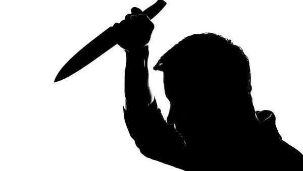 A man holding a knife - Sputnik International