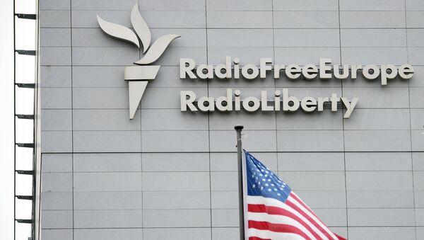 A sign on the headquarters of Radio Free Europe / Radio Liberty international broadcasting organization in Prague - Sputnik International