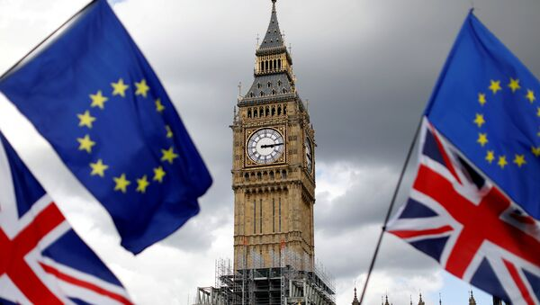 Union Flags and European Union flags fly near the Elizabeth Tower, housing the Big Ben bell, during the anti-Brexit 'People's March for Europe', in Parliament Square in central London, Britain September 9, 2017 - Sputnik International