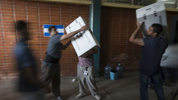 Workers load boxes filled with election ballots at the Supreme Electoral Tribunal warehouse to be transferred to a voting center, in Tegucigalpa, Honduras, Saturday, Nov. 25, 2017 - Sputnik International