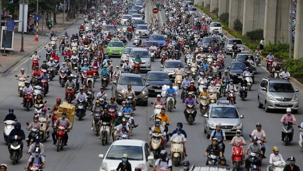 In this June 21, 2017, photo, motorbikes and cars fight for space on a street in Hanoi, Vietnam - Sputnik International