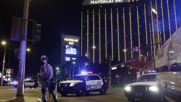 Police officers stand along the Las Vegas Strip near the Mandalay Bay resort and casino during a shooting at a country music festival, in Las Vegas. (File) - Sputnik International