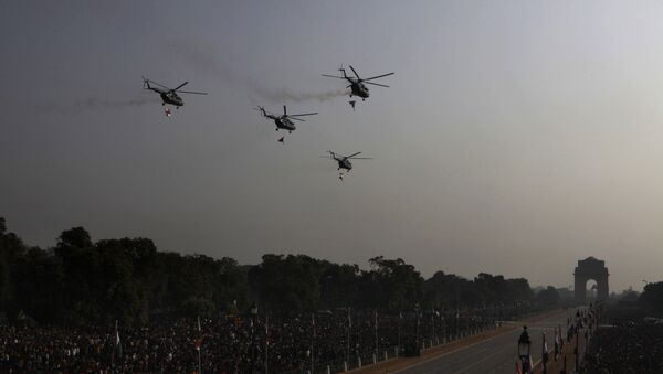 Mi-17 helicopters shower flower petals before the start of the Republic Day parade in New Delhi, India, Wednesday, Jan. 26, 2011 - Sputnik International