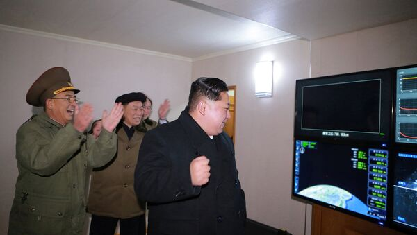 North Korea's leader Kim Jong-un is seen as the newly developed intercontinental ballistic rocket Hwasong-15's test was successfully launched, in this undated photo released by North Korea's Korean Central News Agency (KCNA) in Pyongyang November 30, 2017 - Sputnik International