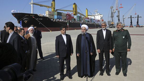 Iranian President Hassan Rouhani, center, speaks during the inauguration a newly built extension of the port of Chabahar, near the Pakistani border, on the Gulf of Oman, southeastern Iran, Sunday, Dec. 3, 2017 - Sputnik International
