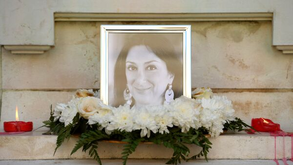 Flowers and tributes lay at the foot of the Great Siege monument in Valletta, Malta, on October 19, 2017 which has been turned into a temporary shrine for Maltese journalist and blogger Daphne Caruana Galizia (picture) who was killed by a car bomb outside her home in Bidnjia, Malta, on October 16, 2017 - Sputnik International