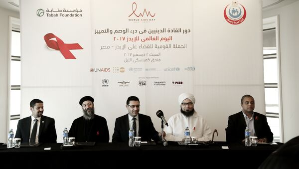 In this Saturday, Dec. 2, 2017 photo, from left to right UNAIDS country manager Ahmed Khamis, Christian father Boulos Soror, Dr. Walid Kamal, Islamic scholar and Sheik Ali al-Jifri, and Tabah Foundation member Mohammed Shahin, prepare for an even part of the World AIDS Day 2017 national advocacy campaign at a hotel, in Cairo, Egypt - Sputnik International