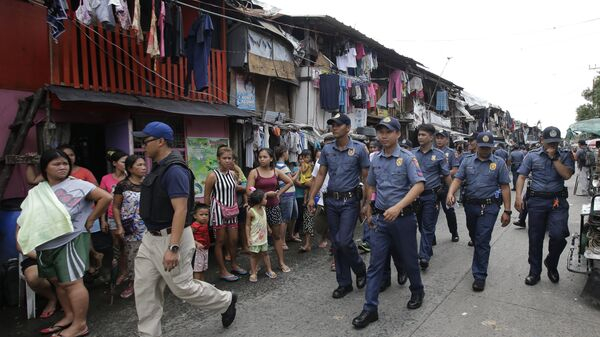 (File) Policemen patrol around a slum area during a police operation as part of the continuing War on Drugs campaign of Philippine President Rodrigo Duterte in Manila, Philippines on Thursday, Oct. 6, 2016 - Sputnik International