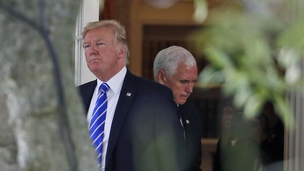 President Donald Trump steps out of the Oval Office, with Vice President Mike Pence behind him, as Trump walks to board Marine One at the White House, Tuesday, Sept. 26, 2017, in Washington - Sputnik International